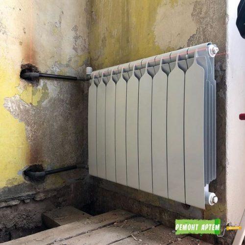 Установка радиатора отопления в квартире в Артёме